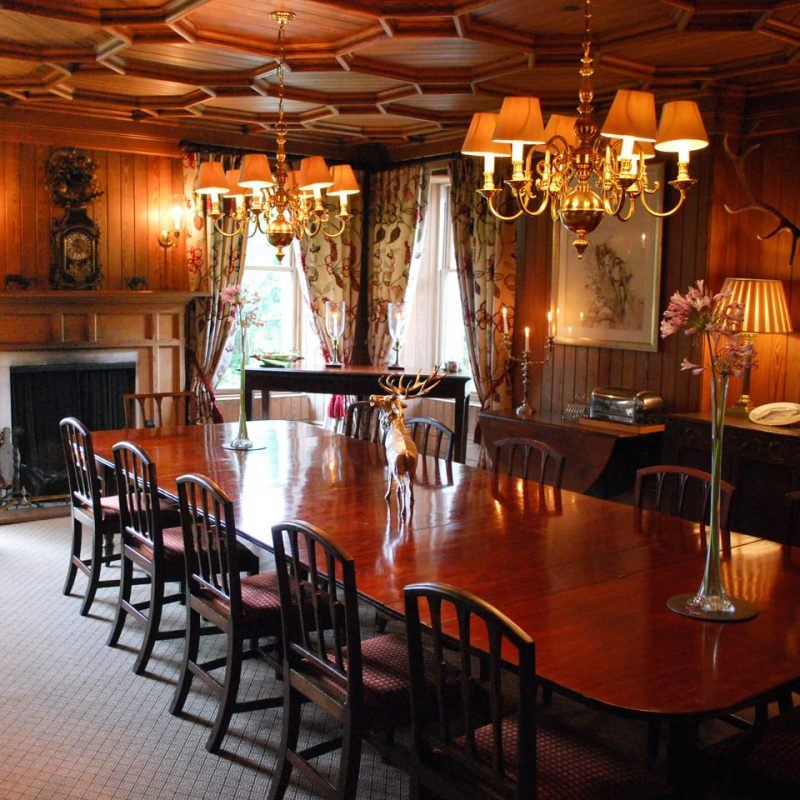 Dining room and fireplace in Letterewe Lodge