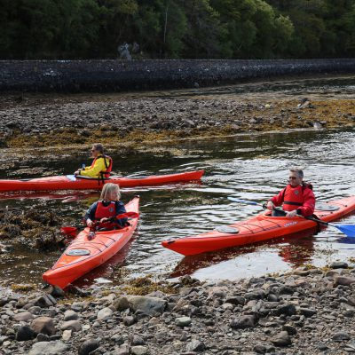 Canoe and Kayak fleet on the shores of Gairloch