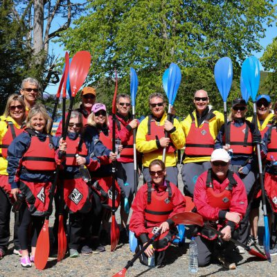 Team kayaking in Scotland